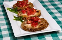 plate of fresh bruschetta with tomatoes - stock photo