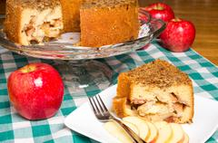 apple cake on display with red apple - stock photo