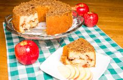 Apple cake with sliced apples on plate Stock Photos
