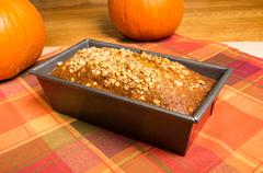 pan of pumpkin bread fresh from the oven - stock photo