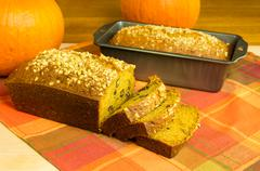 Stock Photo of pumpkin bread loaf sliced with pumpkins
