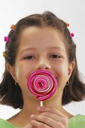 Small girl with lollipop Stock Photos