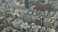 Aerial view of Tokyo's architecture by day, Japan Stock Footage