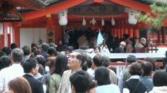 Japanese tourists enter a temple complex at Miyajima island Stock Footage