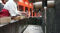Ritual cleansing at the entrance of a Japanese temple Stock Footage