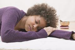 Young woman asleep during a relaxation exercise Stock Photos