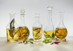 Five different flavoured vinegars - stock photo
