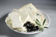 Gorgonzola and sheep's cheese with black olives Stock Photos
