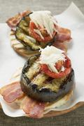 Bacon, grilled aubergine, tomato and Parmesan on toast Stock Photos