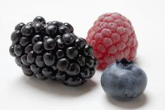 Raspberry, blackberry and blueberry (close-up) Stock Photos