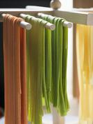 Home-made ribbon pasta hanging up to dry Stock Photos