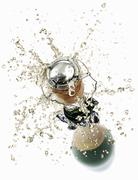 Cork flying out of a sparkling wine bottle - stock photo