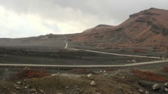 Lonely travelers walking through a volcanic landscape in Southern Japan Stock Footage