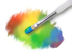 rainbow paint splatter texture with paintbrush - stock photo