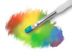 Rainbow paint splatter texture with paintbrush Stock Photos