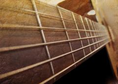 Old brown acoustic guitar closeup Stock Photos