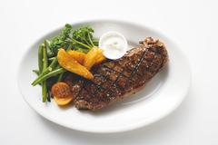 Grilled beef steak with vegetables and dip Stock Photos