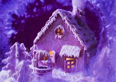 Gingerbread house in purple light Stock Photos