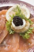 Smoked salmon with caviar and sour cream canapé Stock Photos