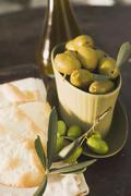 Green olives and crackers Stock Photos