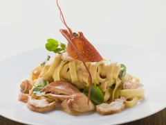 Ribbon pasta with lobster Stock Photos