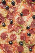 Pepperoni pizza with peppers and olives (full-frame) Stock Photos