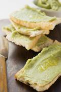 Avocado spread on bread - stock photo