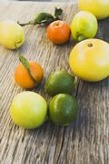 Assorted citrus fruit on wooden background Stock Photos