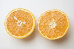 Two orange halves - stock photo