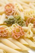Stock Photo of Coloured animal-shaped pasta and penne