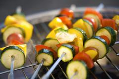 Vegetable kebabs on barbecue Stock Photos