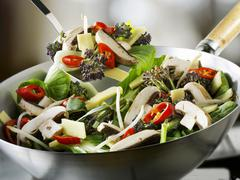 Vegetables and mushrooms in wok Stock Photos