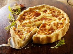 Quiche Lorraine, a slice cut - stock photo