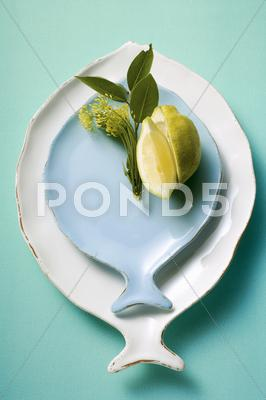 Stock photo of White and blue fish plates, decorated with lemon