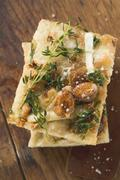 Focaccia with goat's cheese and almonds - stock photo
