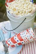 Popcorn in a wooden bucket for the 4th of July (USA) - stock photo