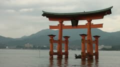 Tourists on an old 'sampan' visiting 'floating torii gate' in Japan Stock Footage