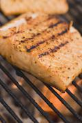 Stock Photo of Salmon fillets on a barbecue