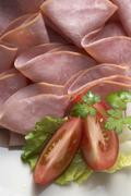Many slices of ham (detail) Stock Photos