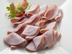 Many slices of ham (overhead view) - stock photo