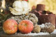 Christmas decoration with red apples and cones Stock Photos