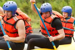 Group Of Young Athletes Training For Whitewater Rafting Stock Photos