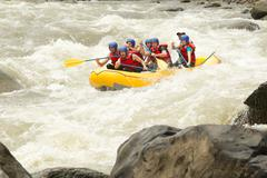 A Group Of Men And Women With A Guide White Water Rafting On The Patate River Stock Photos