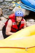 Young Athlete Training For Whitewater Rafting - stock photo