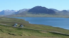 Iceland Miklavaln with fjord and houses c Stock Footage