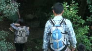 Stock Video Footage of Japanese teacher and schoolkids descend on a mountain path
