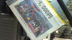 'Take your picture for 1000 yen' at a tripod on Miyajima island, Japan Stock Footage