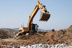 Working excavator Stock Photos