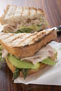 Turkey, avocado and asparagus in toast sandwich - stock photo