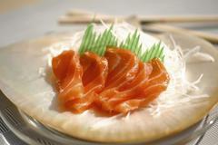 Salmon sashimi with daikon radish Stock Photos